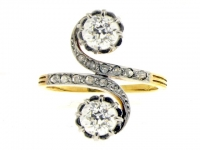 Diamond cross/over ring in yellow gold and platinum.
