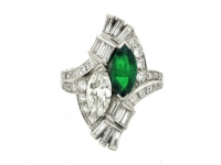 Emerald and diamond cocktail ring by J. E. Caldwell, American, circa 1940.