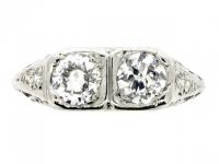 Art Deco two stone diamond ring with diamond set shoulders, circa 1930.