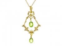 Peridot and natural pearl pendant necklace, English, circa 1905.