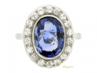 front view Sapphire and diamond cluster ring, English, circa 1920.
