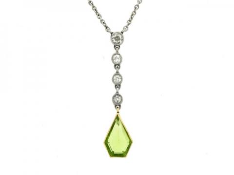 Peridot and diamond pendant necklace, circa 1920.