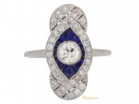 front view Belle Époque diamond and calibré sapphire ring, circa 1910.