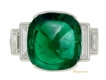 alt='Art Deco emerald cabochon and diamond ring, circa 1935.'