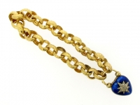 Antique gold bracelet with enamel and diamond heart locket, circa 1840.
