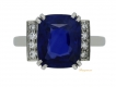 alt='Art Deco natural sapphire ring with diamond set shoulders, circa 1935.'