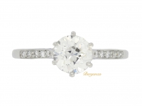 Solitaire old cut diamond ring with diamond set shoulders, circa 1920.