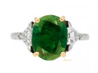 front view Antique solitaire Colombian emerald ring with diamond set shoulders, circa 1910.