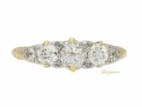 front view Antique diamond three stone carved ring, circa 1905.