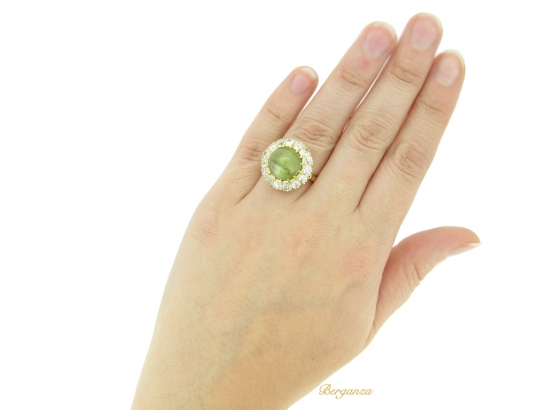 hand view Antique cat's eye chrysoberyl and diamond cluster ring