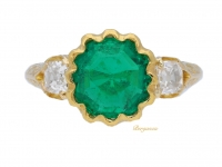front view Antique solitaire emerald and diamond ring, circa 1900.