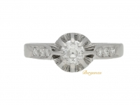 front view Antique solitaire diamond ring with diamond set shoulders, French, circa 1915.