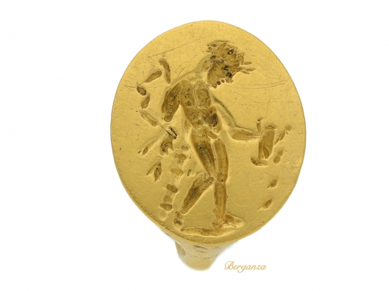 front view Ancient Greek gold ring with Apollo, circa 4th century BC.