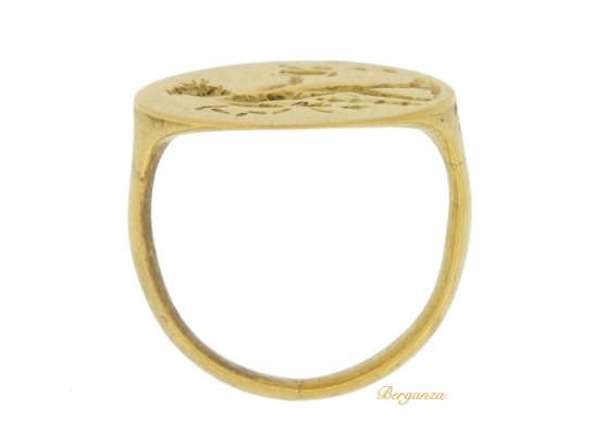 back view Ancient Greek gold ring with Apollo, circa 4th century BC.
