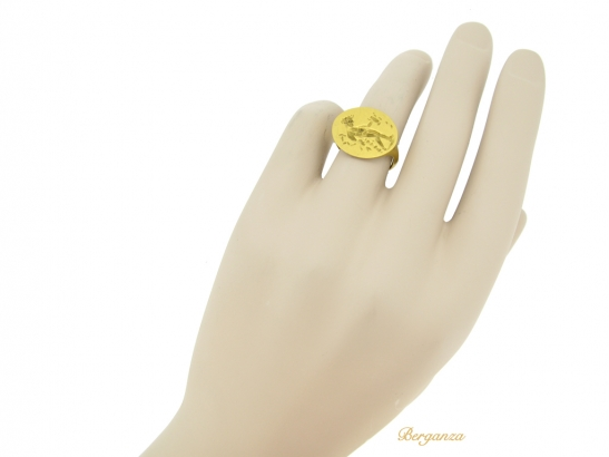 hand view Ancient Greek gold ring with Apollo, circa 4th century BC.