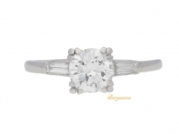 front view Vintage solitaire diamond engagement ring with diamond set shoulders, American, circa 1950.