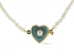 alt='front view Natural pearl necklace with enamel heart shape clasp, circa 1900.'