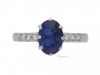 front view Solitaire sapphire ring with diamond set shoulders, circa 1915.