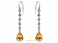 Imperial topaz and rose diamond earrings, circa 1920.