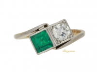 front view Emerald and diamond cross over ring, circa 1940.