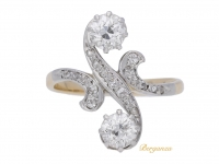 front view Art Nouveau diamond two stone cross over ring, circa 1905.