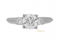 front view Solitaire diamond engagement ring with diamond set shoulders, American, circa 1930.
