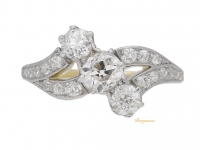 front view Antique diamond three stone cross over ring, circa 1910.