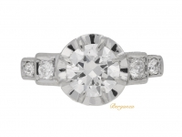 front view Solitaire diamond engagement ring with diamond set shoulders, French, circa 1925.