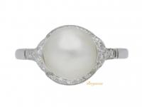 front view Natural pearl and diamond ring, circa 1920.