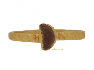 front view Medieval engraved gold amethyst ring, circa 14th-15th century.
