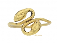 front view Egyptian gold twin headed serpent ring, circa 30 BC-323 AD.
