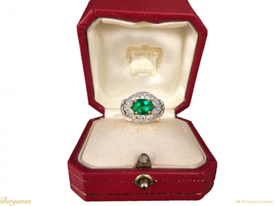 boxed-view--Emerald-and-diamond-cluster-ring-by-Cartier-Paris,circa-1970-hatton-garden-berganza