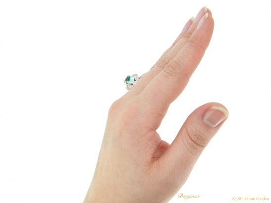 hand-view--Emerald-and-diamond-cluster-ring-by-Cartier-Paris,circa-1970-hatton-garden-berganza