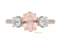 front view Peach sapphire and diamond three stone ring, circa 1915.