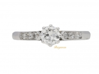 front view Solitaire diamond ring with diamond set shoulders, circa 1920.