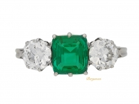 front view Emerald and diamond three stone ring, circa 1920.