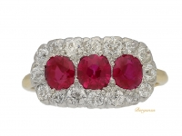 front view Edwardian ruby triple cluster ring, English circa 1910.