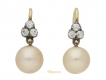 alt='front view Victorian natural pearl and diamond earrings, English, circa 1890.'