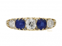front view Antique carved five stone sapphire and diamond ring, English, circa 1900.