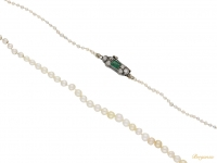 front view Antique pearl necklace with an emerald and diamond clasp, circa 1890.