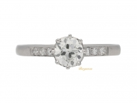 front view Flanked solitaire diamond engagement ring, circa 1920.