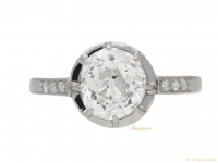 front view Flanked cushion shape old mine diamond ring, French, circa 1920. Berganza hatton garden