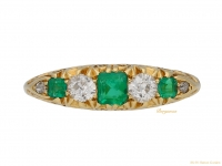 front view Emerald and diamond carved ring, English, circa 1902. berganza hatton garden
