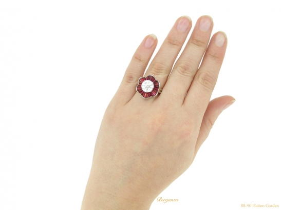 hand-view-Diamond-and-ruby-cluster-ring-by-Oscar-Heyman-Brothers,-circa-1970.-berganza-hatton-garden