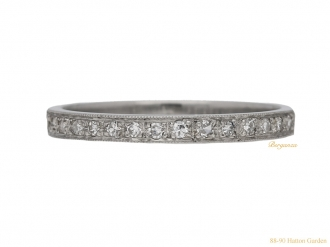 Diamond set half eternity ring, English, circa 1950.