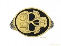 front-view-Stuart-enameled-skull-ring,berganza-hatton-garden