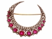 alt='A Victorian ruby and diamond crescent brooch, English, circa 1885. '