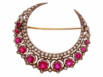 front-view-A Victorian ruby and diamond crescent brooch, English, circa 1885.