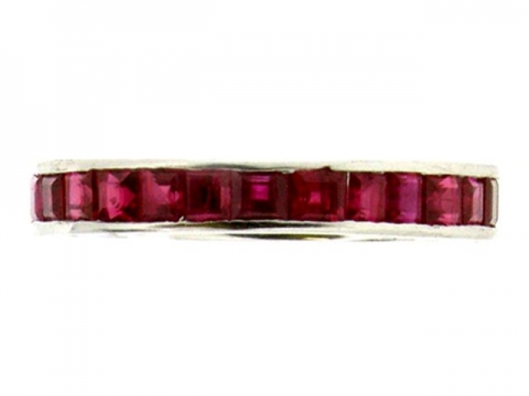 A ruby set eternity ring in platinum.