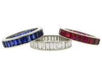 Three full eternity rings, in rubies, diamonds and sapphires, circa 1939.